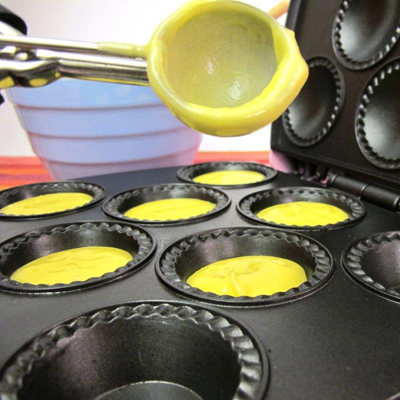 Spooning batter into babycakes cupcake maker