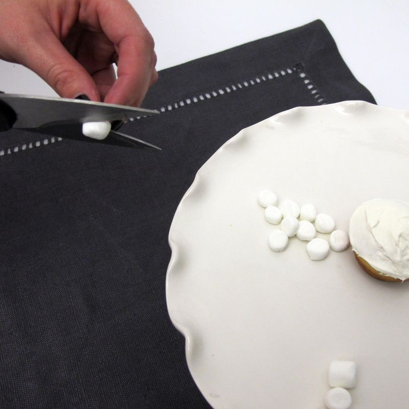 Cutting mini marshmallows for baby lamb cupcake design